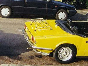 Photo of Triumph Spitfire with a luggage rack screwed to the boot lid